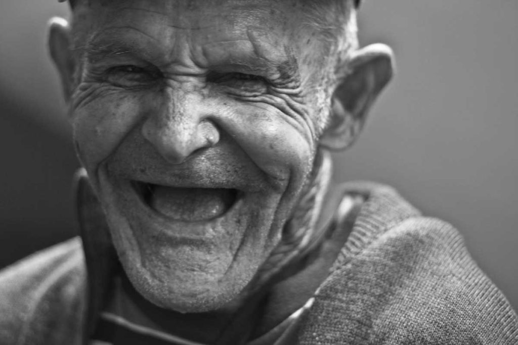 old man with a big smile